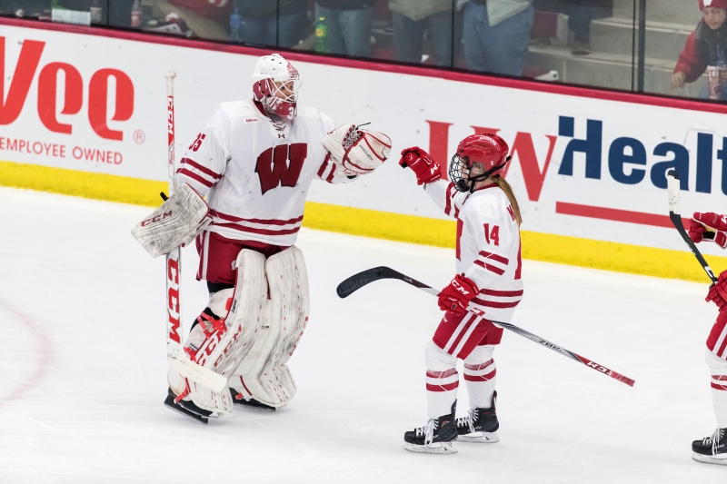 Wisconsin Badgers Alexis Mauermann (14) celebrates a goal with goalie Kristen Campbell (35) during an NCAA women's hockey game against the Ohio State Buckeyes Sunday, November 5, 2017, in Madison, Wis. The Badgers won 3-1. (Photo by David Stluka)