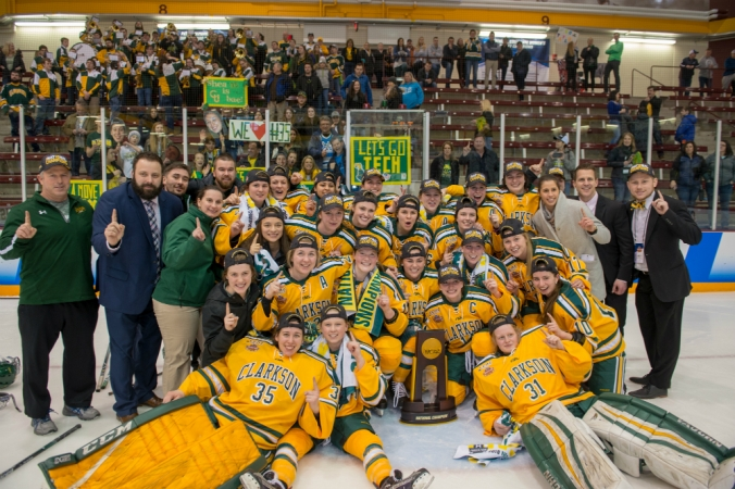 The 2018 Clarkson Golden Knights pose for a photo around the national championship trophy at Ridder Arena. (Clarkson Athletics)