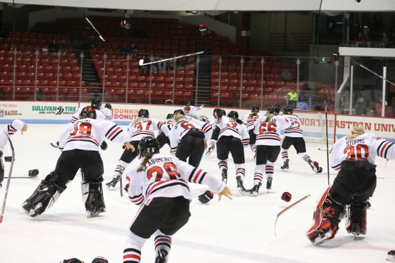 The Northeastern women's hockey team celebrates after defeating UConn to win the 2018 Hockey East Tournament title and earn an automatic bid into the NCAA Tournament.