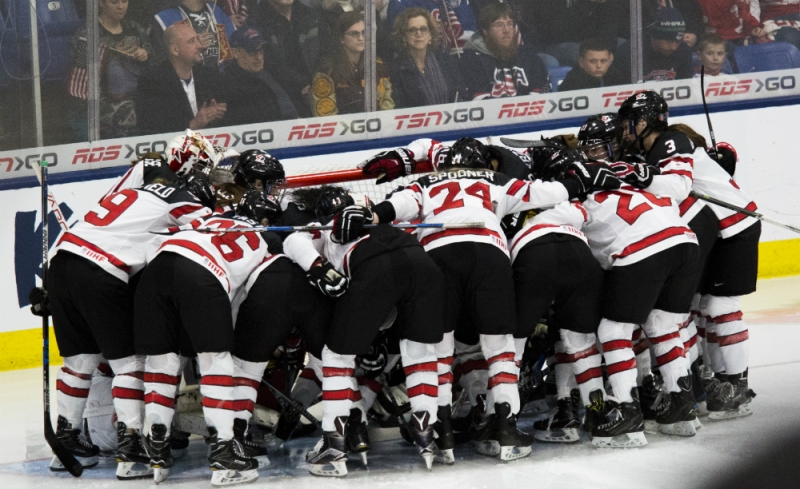 Team Canada huddles around their net before a game against the United States at the 2017 IIHF Women's World Championship. (Michelle Jay)