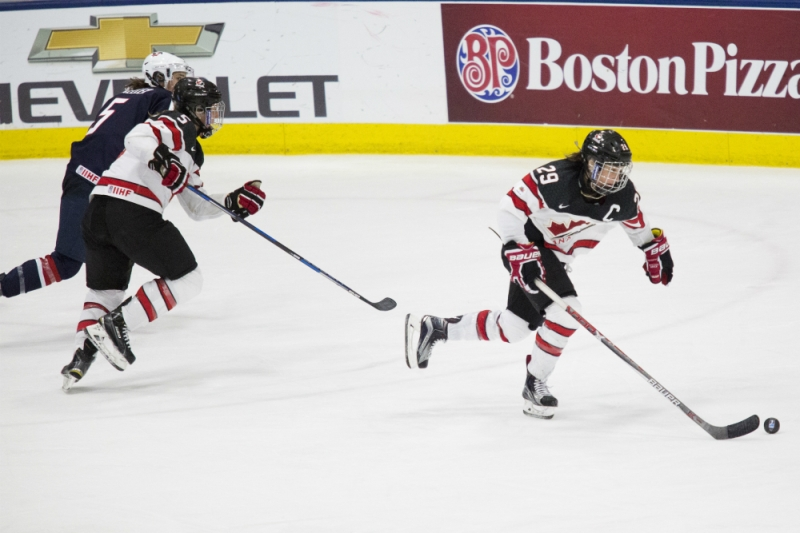 Marie-Philip Poulin carries the puck out of Canada's zone in the gold medal game vs. the United States at the 2017 IIHF Women's World Championship. (Michelle Jay)