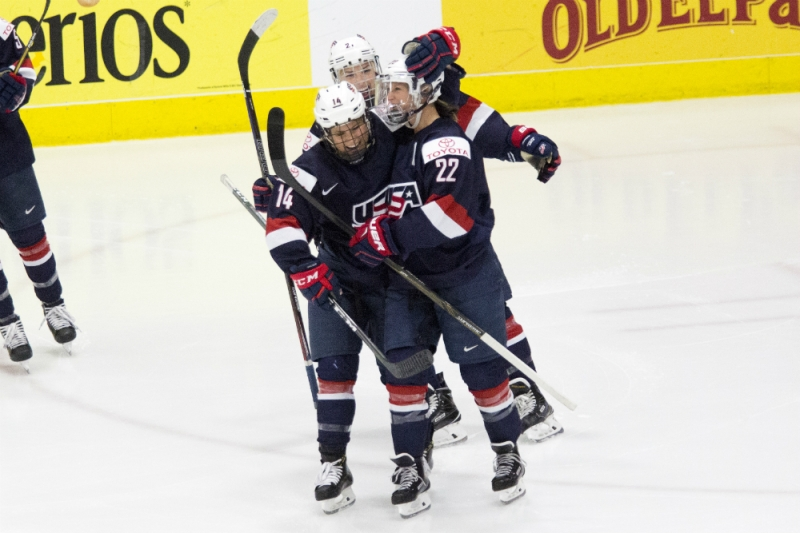 Team USA's Brianna Decker, Kacey Bellamy, and Hilary Knight celebrate a goal against Canada at the 2017 IIHF Women's World Championship. (Michelle Jay)