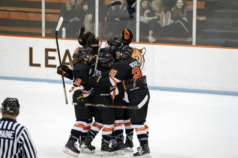 Princeton's women's ice hockey players, including Carly Bullock, Sharon Frankel, and Annie MacDonald, celebrate a goal at Hobey Baker Rink. (Shelley Szwast/Princeton Athletics)