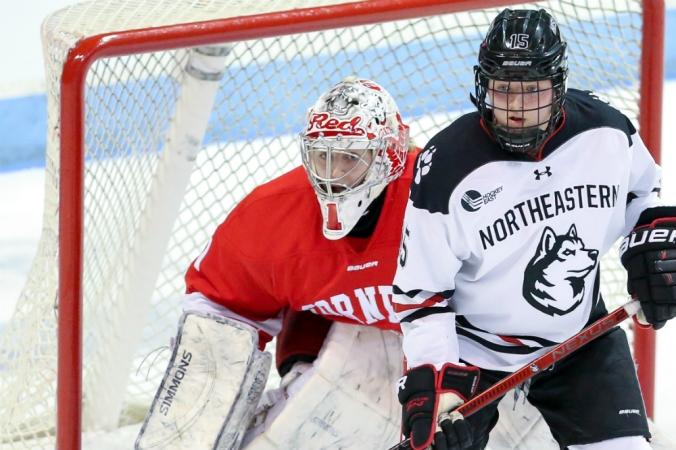 Cornell goaltender Marlène Boissonnault defends her net with a Northeastern defender in front. (Jim Pierce/Cornell Athletics)