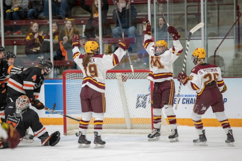 """Minnesota's """"Pots and Pan"""" line of Kelly Pannek, Sarah Potomak, and Amy Potomak celebrate a goal in the Gophers' 2019 NCAA Tournament quarterfinal game against Princeton. (Jim Rosvold/Gopher Athletics)"""
