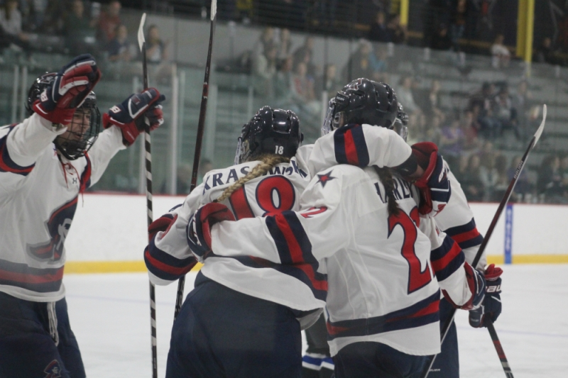 Robert Morris forwards Mackenzie Krasowski (#18) and Emilie Harley (#22) celebrate a goal with their teammates during an exhibition game against the University of Ontario Institute of Technology on Sept. 22, 2018. (Sara Beth Johnson/RMU Athletics)