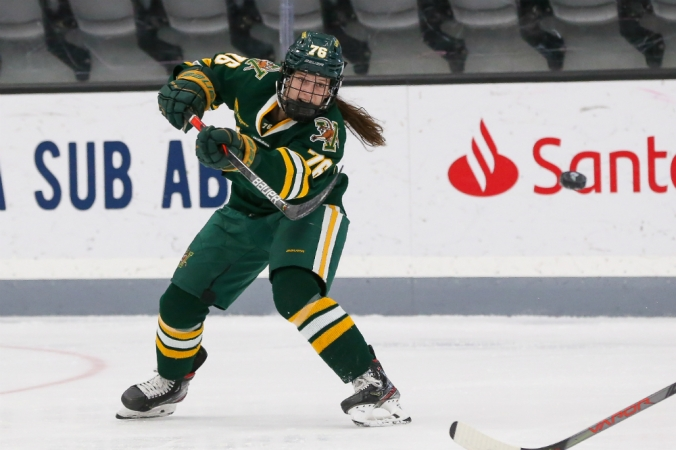 Vermont defender Maude Poulin-Labelle fires a pass across the ice to a teammate. (Brian Foley)