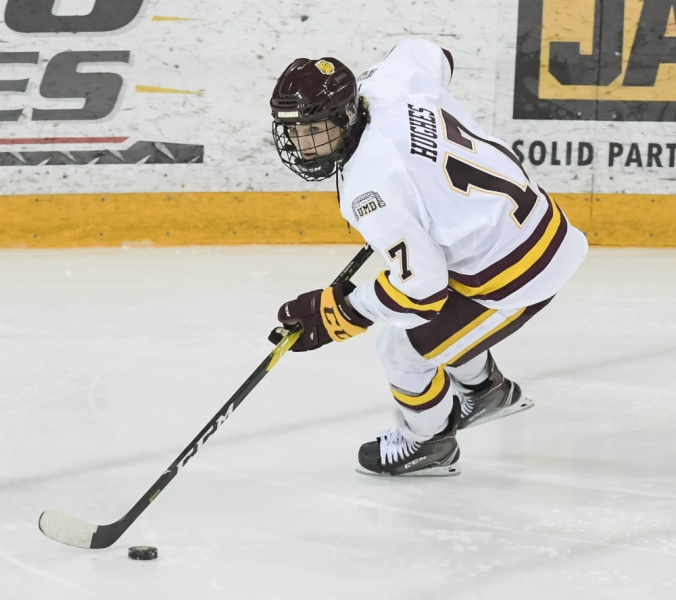 Minnesota Duluth forward Gabbie Hughes carries the puck near the goal line in a game against Minnesota. (UMD Athletics)