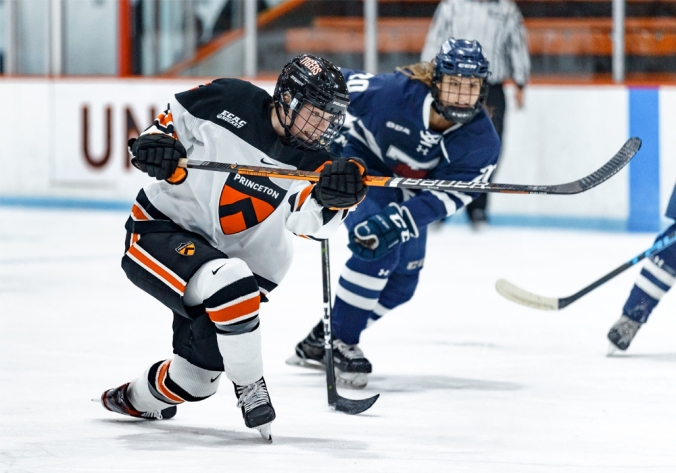 Princeton captain and defender Claire Thompson drops her knee while taking a shot in a game against the University of Toronto during the 2019-20 season.