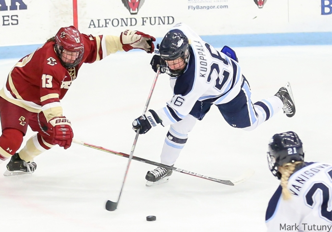 Maine forward Ida Kuoppala battles for the puck in the slot against a Boston College defender.
