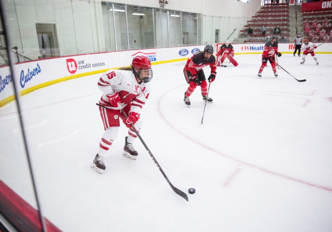 Caitlin Schneider holds the puck in the corner and looks for an option against Ohio State.
